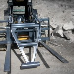 Heavy duty skid steer mat grapples, installed on a skid steer, painted grey, manufactured by Tysea mfg inc.